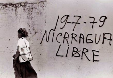 Woman Passing Wall, Managua 1979