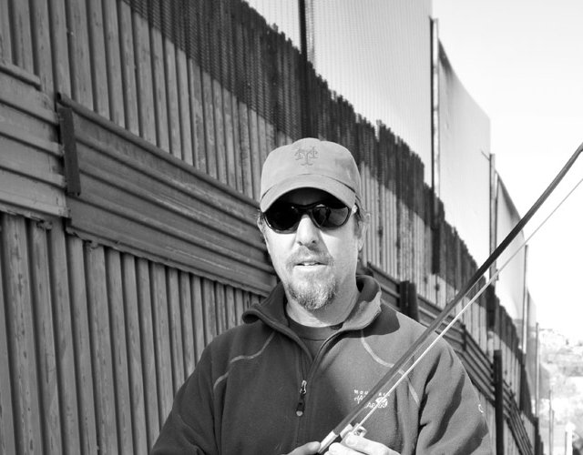 Glenn Weyant About to Play the Border Wall, Nogales 2010
